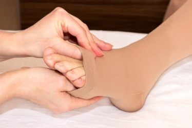 how to put on compression stockings easily